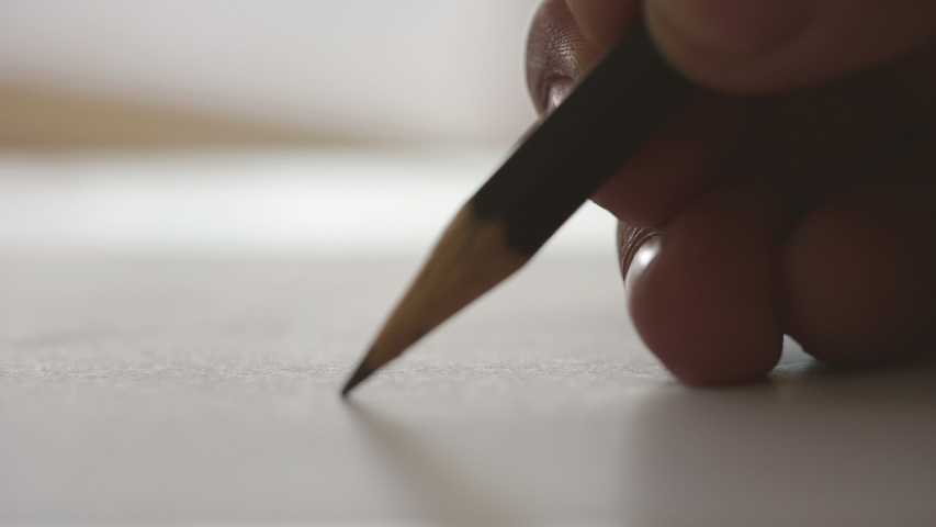 Close-up writing on a piece of paper. Writing love letters