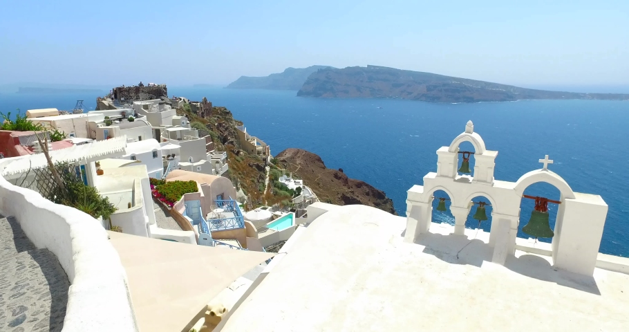 Bell tower in Oia town.White architectural buildings on high rocks, Mediterranean sea view from top of Santorini island/Santorini is one of the Cyclades group islands,Greece  | Shutterstock HD Video #1033345823