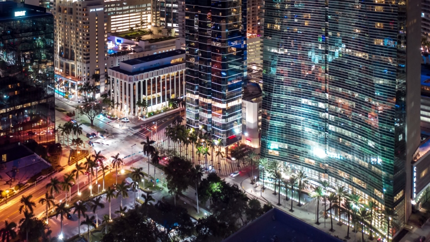 Aerial view of Miami hyperlapse 4k drone panorama view flight over downtown Miami at night. Best aerial shot of Miami city. Drone flying over a city night lights Miami