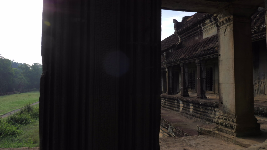Cinematic slide of ancient Angkor Wat temple ruins in Siem Reap, Cambodia | Shutterstock HD Video #1033549643
