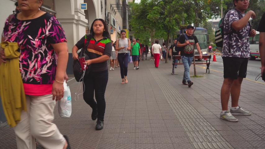 Lima, Peru. Circa 2019. People in street walking cars transportation
