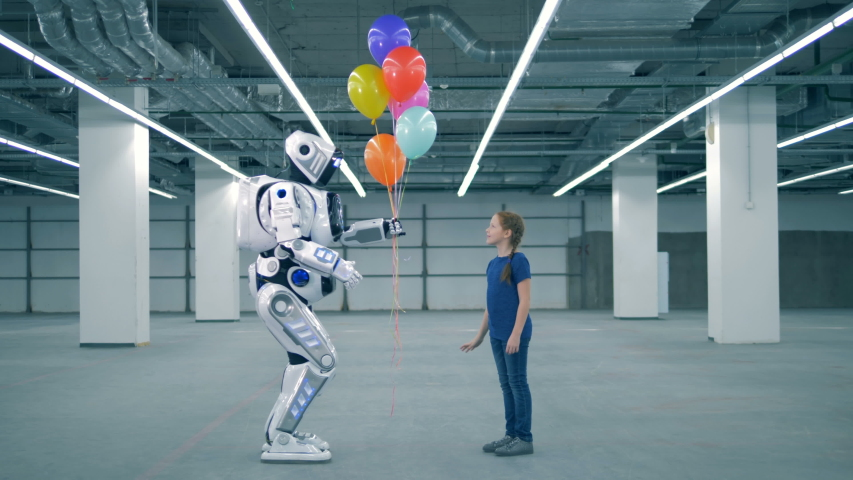 One girl gives balloons to a droid, side view. | Shutterstock HD Video #1033569803