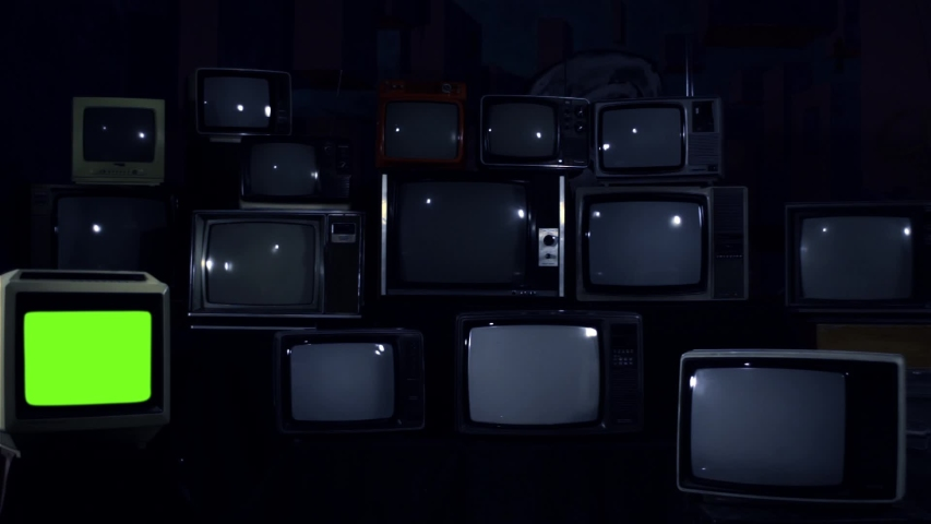 Retro TV Turning On Green Screen over a Pile of Retro TVS from the 80s and 90s. Blue Dark Tone. | Shutterstock HD Video #1033573523