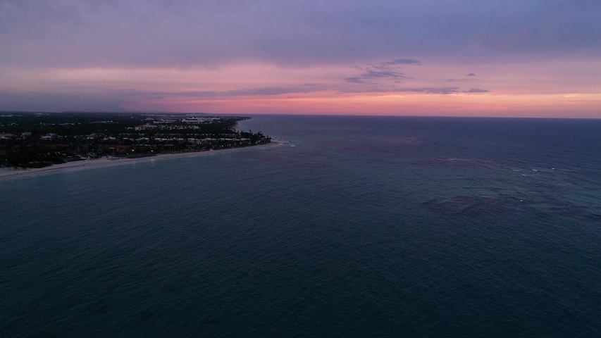 Colorful Beach Sunset Over Dark Ocean at Night, Aerial Drone | Shutterstock HD Video #1033582703