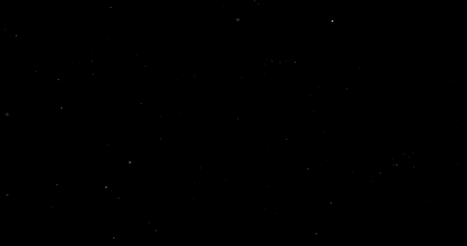 Flying dust particles on a black background   Shutterstock HD Video #1033610003