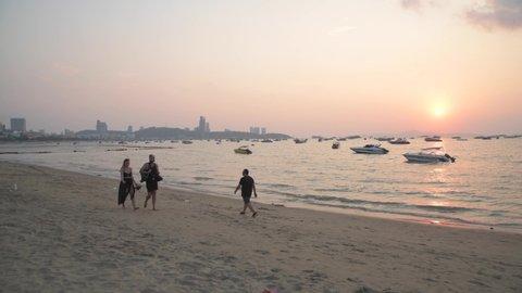 pattaya, pattaya / Thailand - 02 09 2019: couple men and women walking in sunset beach travel in pattaya city