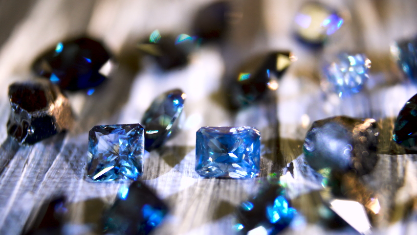 Jewel. Sparkling Blue Sapphire. Gemstone of Kings. Close up | Shutterstock HD Video #1034166683
