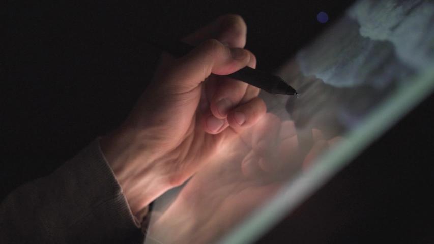 Creative Digital artist photographer edit his artwork on interactive tablet computer   Shutterstock HD Video #1034217053