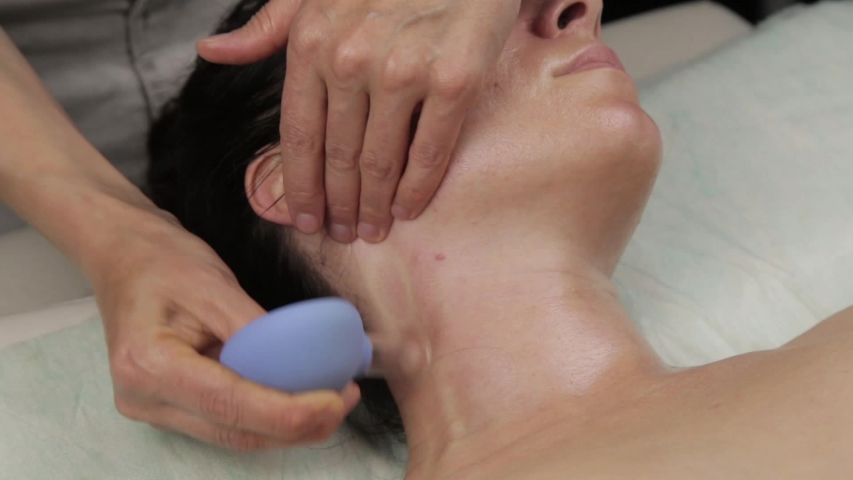 Beautician does anti-aging neck massage with vacuum banks. vacuum face massage for skin regeneration | Shutterstock HD Video #1034351993
