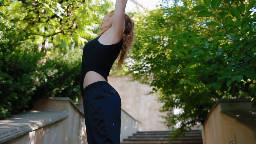 Woman doing bearhing exercise outdoors | Shutterstock HD Video #1034430893
