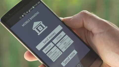 Using a smartphone device to send money founds to another person. Internet banking on mobile device.