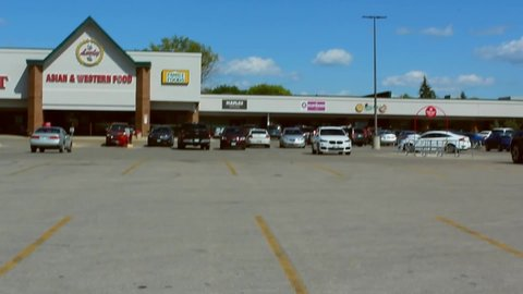 Winnipeg , MB / Canada - 07 27 2019: 07 27 2019 - Winnipeg, Mb / Canada. Car driving in parking lot at Lucky's Supermarket.
