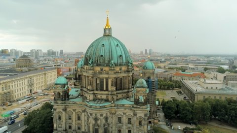 Aerial Panorama of Berlin Cathedral - main church in Mitte borough in Berlin, Germany, called Berliner Dom. 4K Drone Panning Shot of European Capital Cityscape on Overcast Summer Day