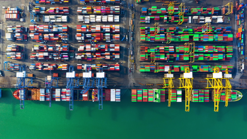 Container ship loading and unloading in deep sea port, Aerial view of business logistic import and export freight transportation by container ship, Container loading cargo freight ship, Time Lapse 4K. | Shutterstock HD Video #1034887643