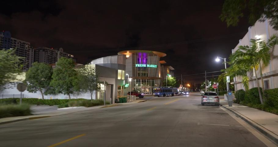 MIAMI BEACH, FL, USA - AUGUST 5, 2019: Fresh Market health food store Miami Beach shot at night with gimbal stabilizer  | Shutterstock HD Video #1034889293