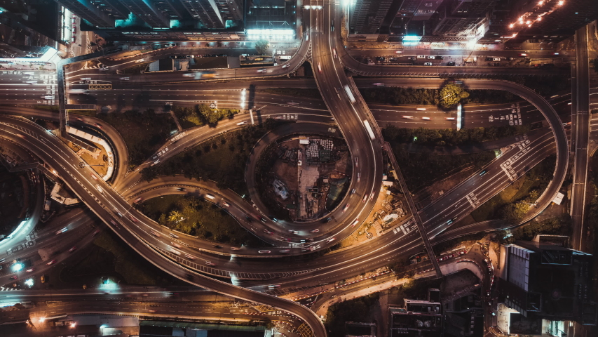 4K UHD top view time-lapse of car traffic at night on multiple lane highway, winding road, and roundabout in Hong Kong city. Commuter, city life, or land transportation concept | Shutterstock HD Video #1034996123