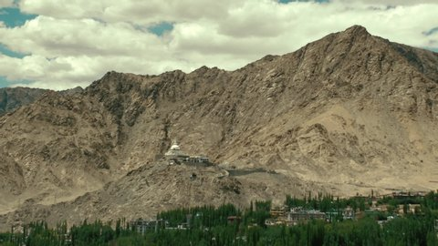 the leh city with house made of mud and local materials crowded the Buddhist flag fluttering due to winds view from leh palace
