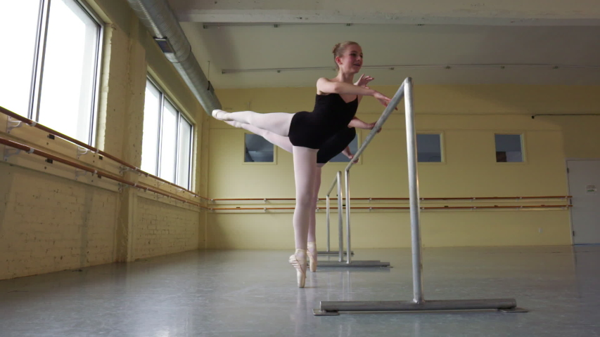 Slow motion shot of ballerinas practicing at the barre #1035164663