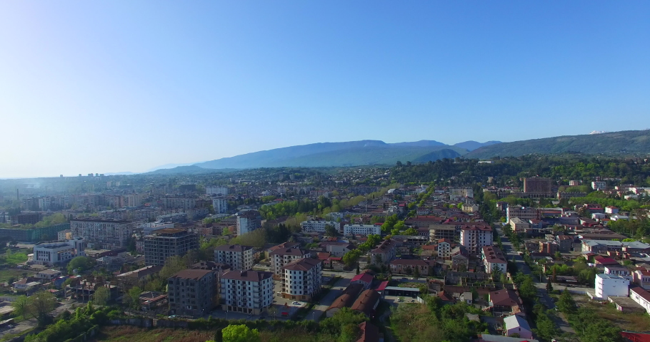 Sukhumi, Abkhazia - September 20, 2018: Aerial view of the urban landscape with buildings and streets. | Shutterstock HD Video #1035177953