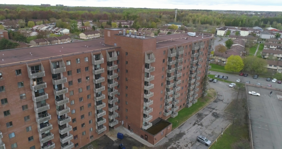 Aerial Drone view of the side of a residential living building in urban area | Shutterstock HD Video #1035206513