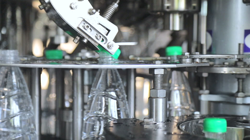 Water bottling line. Automatic feeding of plastic caps and closure | Shutterstock HD Video #1035245003