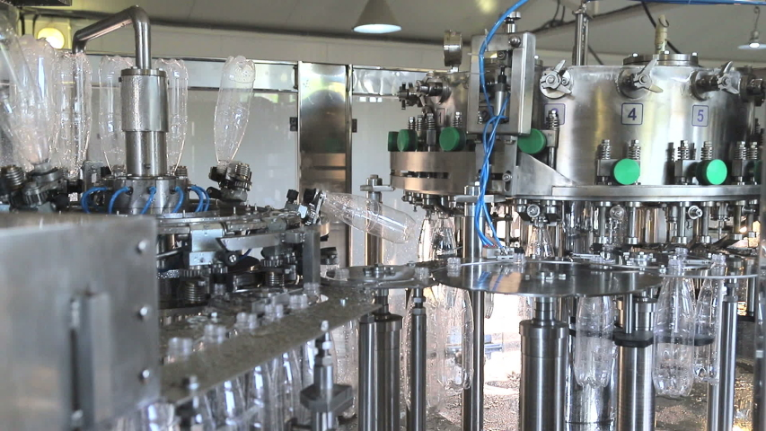 Plant for the production of mineral water. Water bottling in plastic white | Shutterstock HD Video #1035245033