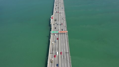 Aerial birds eye view of a highway water bridge in penang, malaysia  car  traffic on the road