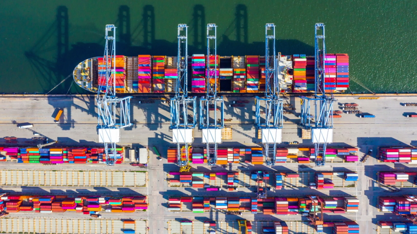 Container ship loading and unloading in deep sea port, Aerial top view of business logistic import and  export freight  transportation by container ship in open sea. | Shutterstock HD Video #1035419393