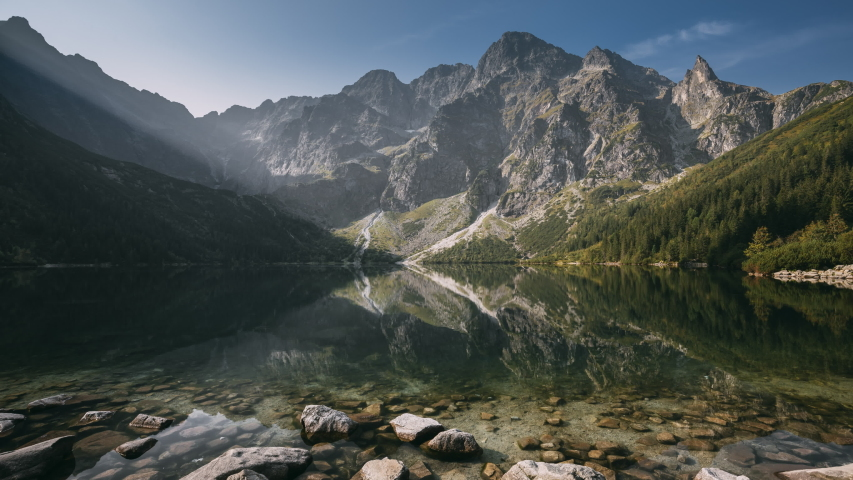 Tatra National Park, Poland. Famous Mountains Lake Morskie Oko Or Sea Eye Lake In Summer Morning Sunrise. Beautiful Sunrays Above Tatras Lake Landscape. | Shutterstock HD Video #1035444113