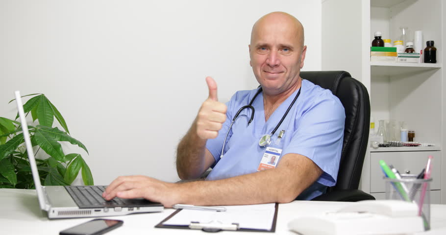 Hospital Clinic Doctor Man Working Computer Holding Thumb Up Sign Smile Gesture ( Ultra High Definition, UltraHD, Ultra HD, UHD, 4K, 2160P, 4096x2160 )   Shutterstock HD Video #10355363