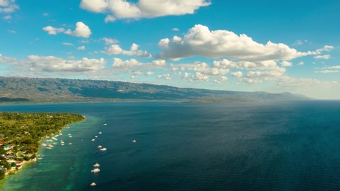 Timelapse: Blue sky with clouds over the sea and islands, aerial view. Seascape: Ocean and sky, Cebu, Philippines.
