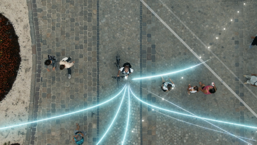 Visualization of Information Global Network. Technology Connecting Lines Flows into Digital Communication Space Flying from Mobile Phone. Young Man Uses Smartphone in the Big City. Aerial Drone Shot