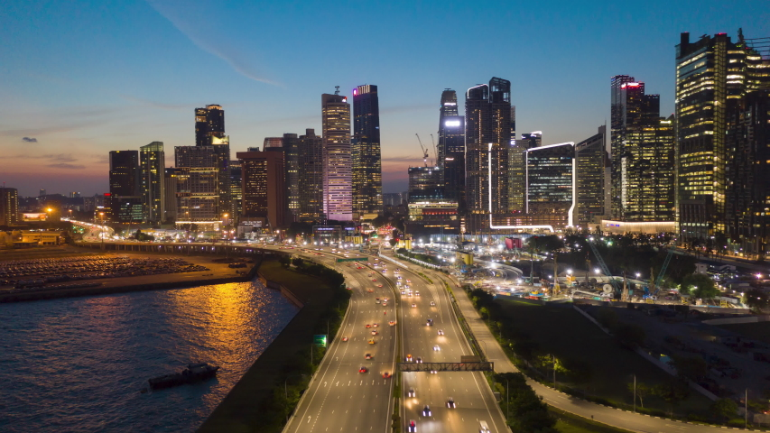 Hyperlapse aerial view flying backward of Road highway along to the night cityscape skyline at Singapore. | Shutterstock HD Video #1035760133