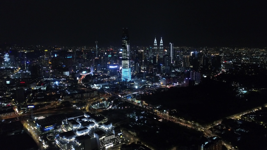 Series of aerial video of Kuala Lumpur city center with New Year's fire works. | Shutterstock HD Video #1035824063