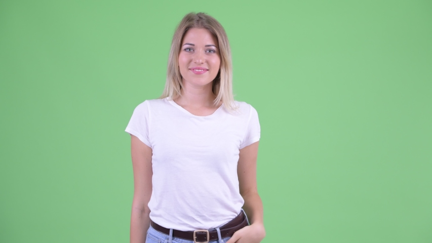 Happy young beautiful blonde woman pointing at camera | Shutterstock HD Video #1035920153
