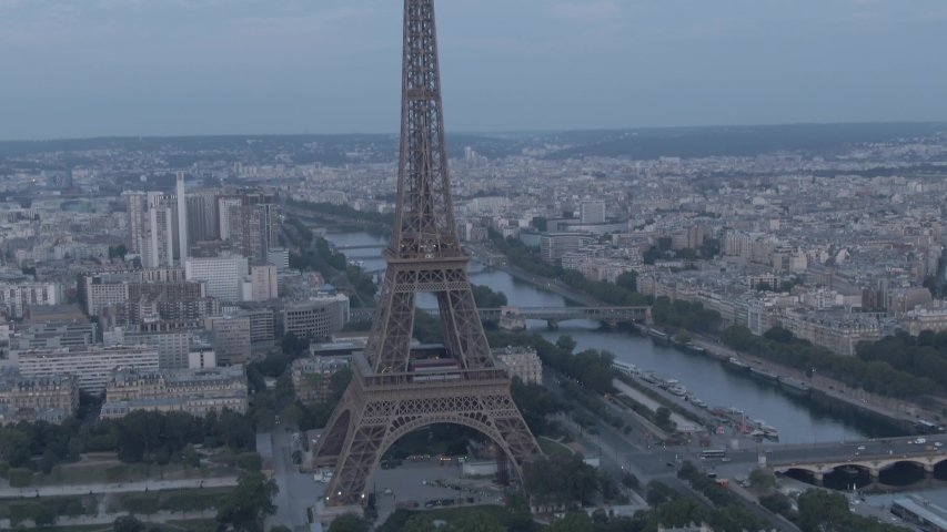 Aerial drone footage of the famous Eiffel Tower in Paris, France in the morning | Shutterstock HD Video #1036003553