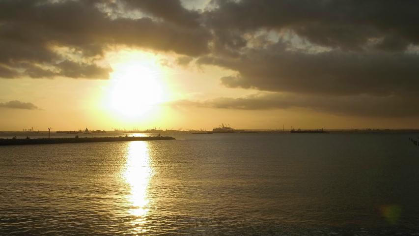Sunset in the breakwater of the Upper New York Bay. | Shutterstock HD Video #1036226003