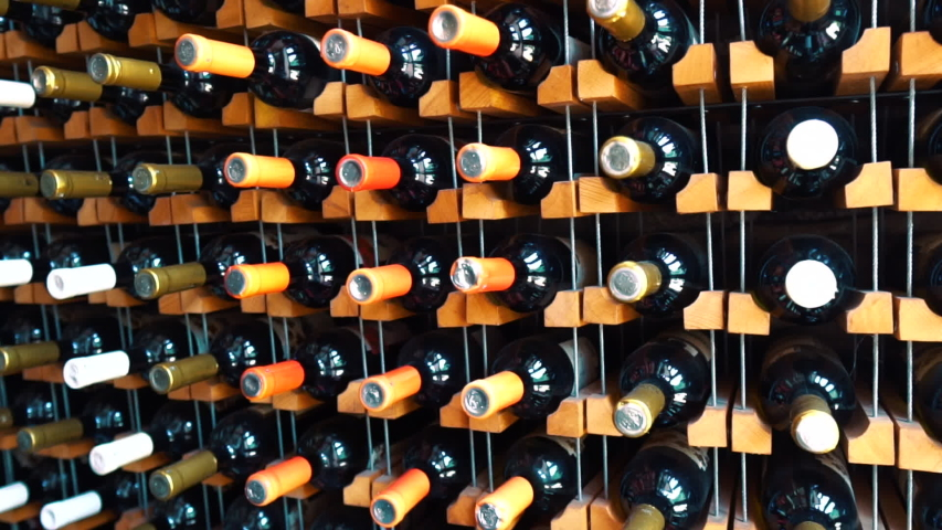 Close Up Lot Bottle Of Wine Lying In Stack At Cellar Storage Process Prepared Beverage Old Wine Cellars A Warehouse With Bottles