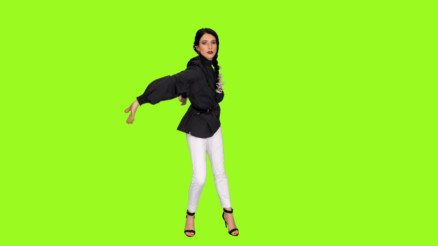 Young charming brunette female dancing sensually against green screen background, Front view, Chroma key 4k footage