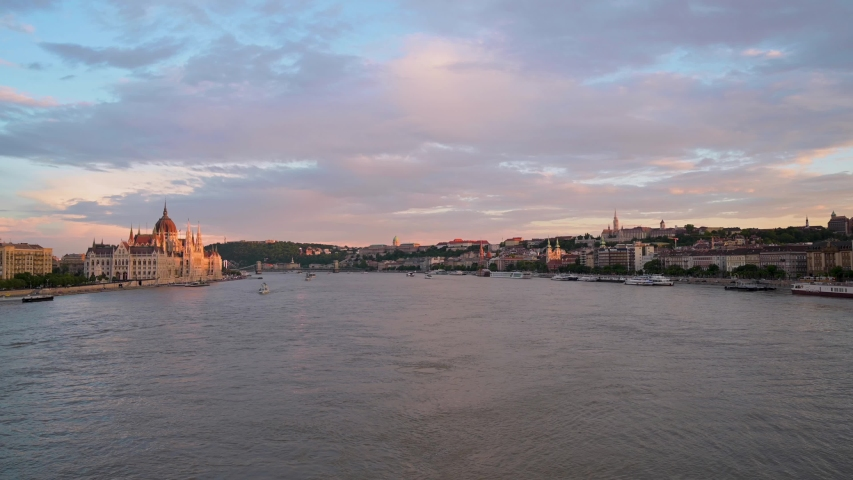 Budapest, Hungary across the Danube River at sunset. | Shutterstock HD Video #1036710893
