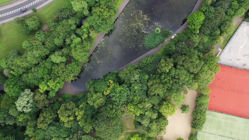 Bird's eye view of a road next to a large river in a suburb. Dublin, Ireland   Shutterstock HD Video #1036806473