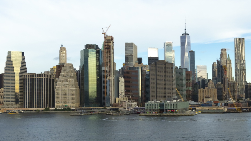 New York time lapse Harbor morning view across the East river to Manhattan Brooklyn Bridge One WTC skyscraper commuter ferries America | Shutterstock HD Video #1036966193