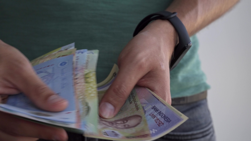 A man counts money from different countries. Hands of a man close-up count money. | Shutterstock HD Video #1036981103