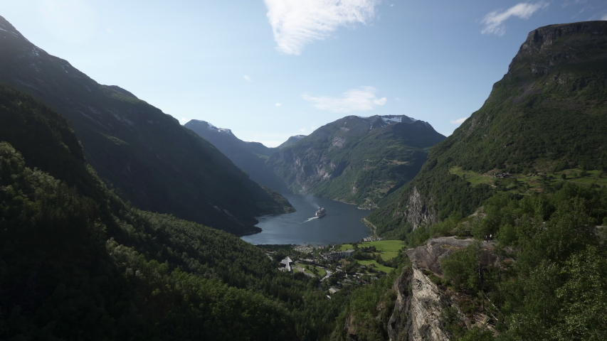 Lockdown: Cruise ship Passing By the Magnificent Valley Full of Nature - Geiranger Fjord, Norway #1037053043