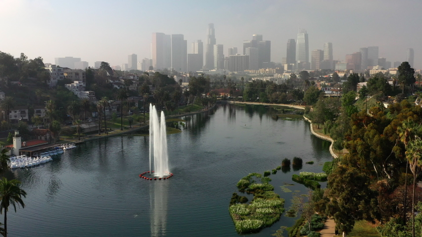 Aerial: Echo Lake on Sunny Day with Los Angeles Skyline - Los Angeles, California | Shutterstock HD Video #1037053523