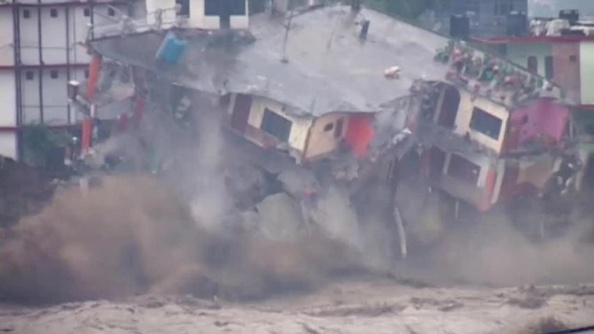 Landslide, flood, cloudburst in india 2013 , killed six to seven thousand pilgrims . Three story building collapsed in Ganga river. | Shutterstock HD Video #1037165723