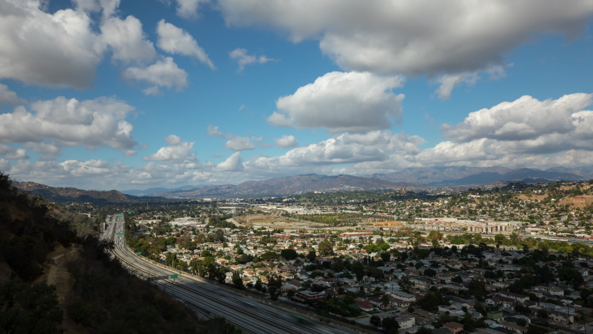 Beautiful clouds over the 5 freeway as it runs through Los Angeles. Time Lapse. | Shutterstock HD Video #1037183753