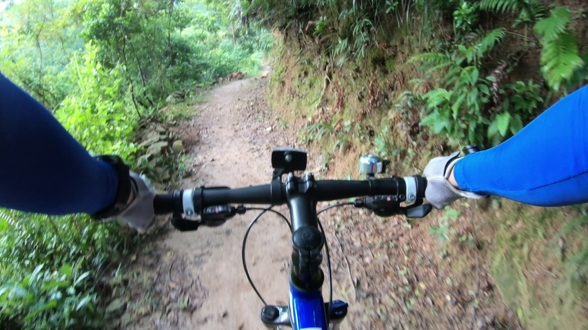 Riding bike on forest trail road  | Shutterstock HD Video #1037274233