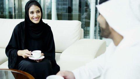 Arab male female kandura abaya leisure UAE hotel travel visitor custom coffee