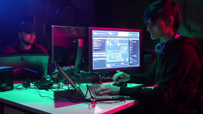 Hackers making cryptocurrency fraud using virus software and computer interface. Blockchain cyberattack, ddos and malware concept. Underground office. | Shutterstock HD Video #1037440283